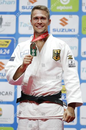 Alexander Wieczerzak (GER) - Judo : Medalist pose with their medal during the 81kg medal ceremony