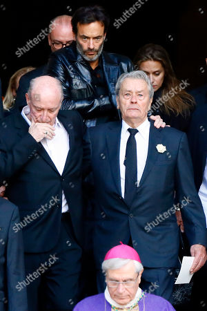 """French actor Alain Delon, right, his son Anthony Delon, top ceter, leave the funeral ceremony for French actress Mireille Darc, with Darc's husband Pascal Desprez, left, at Saint Sulpice church in Paris, . Darc, with a distinctive blond bob, was long seen as a sex symbol and was a fixture on French screens in the 1960s and 1970s. She performed in some 50 films, including Jean-Luc Godard's """"Weekend"""" and Yves Robert's """"The Tall Blond with One Black Shoe"""