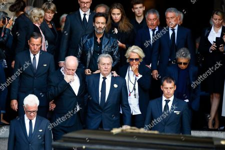 """French actor Alain Delon, center, his son Anthony Delon, top center, leave the funeral ceremony for French actress Mireille Darc, with Darc's husband Pascal Desprez, center left, and Veronique de Villele, center right, at the Saint Sulpice church in Paris, . Darc, with a distinctive blond bob, was long seen as a sex symbol and was a fixture on French screens in the 1960s and 1970s. She performed in some 50 films, including Jean-Luc Godard's """"Weekend"""" and Yves Robert's """"The Tall Blond with One Black Shoe"""
