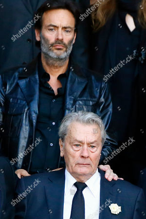 """French actor Alain Delon, and his son Anthony Delon, top, leave the funeral ceremony for French actress Mireille Darc at the Saint Sulpice church in Paris, . Darc, with a distinctive blond bob, was long seen as a sex symbol and was a fixture on French screens in the 1960s and 1970s. She performed in some 50 films, including Jean-Luc Godard's """"Weekend"""" and Yves Robert's """"The Tall Blond with One Black Shoe"""