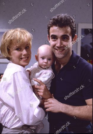 Stock Photo of Sally Dynevor (as Sally Webster), Emma Collinge (as Rosie Webster) and Michael Le Vell (as Kevin Webster)