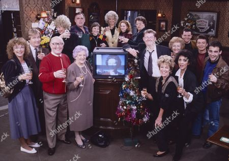 Coronation Street regulars during the Queen's speech at the Rover's Return on Christmas day. l to r, Jill Summers (as Phyllis Pearce), Bill Waddington (as Percy Sugden), Anne Kirkbride (as Deirdre Barlow), William Roache (as Ken Barlow), Elizabeth Dawn (as Vera Duckworth), William Tarmey (as Jack Duckworth), Deborah McAndrew (as Angie Freeman), Julie Goodyear (as Bet Gilroy), Chloe Newsome (as Vicky Arden), Betty Driver (as Betty Turpin), Kevin Kennedy (as Curly Watts), Eileen Derbyshire (as Emily Bishop), Philip Middlemiss (as Des Barnes), Sean Wilson (as Martin Platt), Michael Le Vell (as Kevin Webster), Sue Nicholls (as Audrey Roberts) and Amanda Barrie (as Alma Sedgewick)