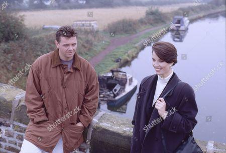 Stock Image of Philip Middlemiss (as Des Barnes) and Colette Stevenson (as Lynette Campion)