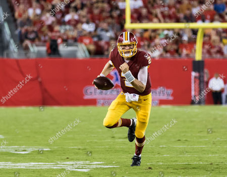 Washington Redskins quarterback Nate Sudfeld (2) runs for yards in the 1st half during the game between the Washington Redskins and the Tampa Bay Buccaneers at Raymond James Stadium in Tampa, Florida