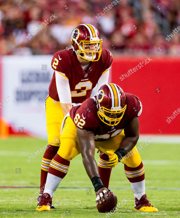 Washington Redskins center Ronald Patrick (62) and Washington Redskins quarterback Nate Sudfeld (2) in the 1st half during the game between the Washington Redskins and the Tampa Bay Buccaneers at Raymond James Stadium in Tampa, Florida