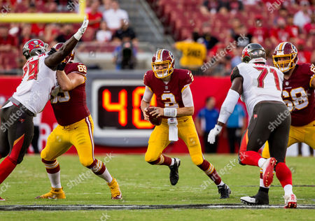 Washington Redskins quarterback Nate Sudfeld (2) runs the ball in the 1st half during the game between the Washington Redskins and the Tampa Bay Buccaneers at Raymond James Stadium in Tampa, Florida