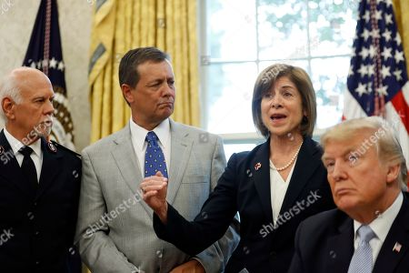 Stock Image of Donald Trump, David Hudson, Kevin Ezell, Gail McGovern President Donald Trump listens with Commissioner David Hudson, National Commander, Salvation Army USA, left, and Kevin Ezell, President of Southern Baptist Disaster Relief, as American Red Cross CEO Gail McGovern speaks about Harvey in the Oval Office of the White House, in Washington