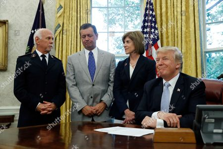 Donald Trump, David Hudson, Kevin Ezell, Gail McGovern President Donald Trump smiles as he speaks about relief efforts for those affected by Harvey, with Commissioner David Hudson, National Commander, Salvation Army USA, left, Kevin Ezell, President of Southern Baptist Disaster Relief, and American Red Cross CEO Gail McGovern, in the Oval Office of the White House, in Washington