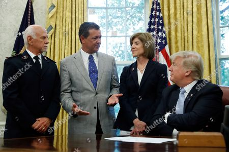 Donald Trump, David Hudson, Kevin Ezell, Gail McGovern President Donald Trump listens with Commissioner David Hudson, National Commander, Salvation Army USA, left, and American Red Cross CEO Gail McGovern, second from right, as Kevin Ezell, President of Southern Baptist Disaster Relief, speaks about Harvey in the Oval Office of the White House, in Washington