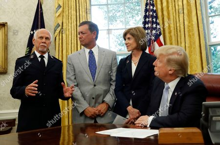Donald Trump, David Hudson, Kevin Ezell, Gail McGovern President Donald Trump addresses Commissioner David Hudson, National Commander, Salvation Army USA, left, Kevin Ezell, President of Southern Baptist Disaster Relief, American Red Cross CEO Gail McGovern, in the Oval Office of the White House, in Washington