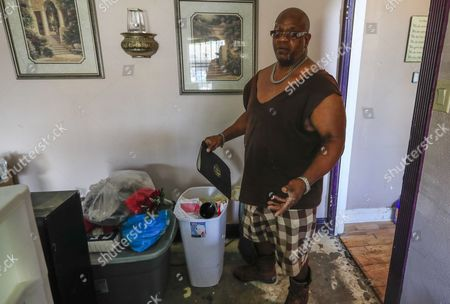 Reginald Brown collects belongings in his flood damaged home as the clean up process begins for him and his neighbors in the aftermath of Hurricane Harvey in Houston, Texas, USA, 01 September 2017. Hurricane Harvey made landfall on the south coast of Texas as a major hurricane category 4. The last time a major hurricane of this size hit the United States was in 2005.