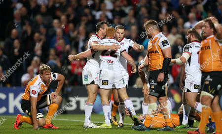 Ulster vs Toyota Cheetahs . Ulster's Peter Nelson celebrates his try with Tommy Bowe and Darren Cave