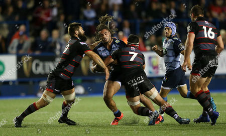 Sion Bennett of Cardiff Blues is tackled by Cornell du Preez and John Hardie of Edinburgh.
