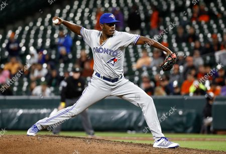 Toronto Blue Jays relief pitcher Carlos Ramirez throws to the Baltimore Orioles during the 10th inning of a baseball game in Baltimore, . It was his major league debut. Baltimore won 1-0 in 13 innings