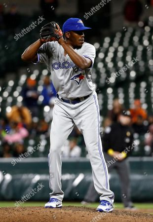 Toronto Blue Jays relief pitcher Carlos Ramirez prepares to throw to the Baltimore Orioles in the 10th inning of a baseball game in Baltimore