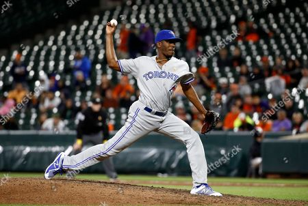 Toronto Blue Jays relief pitcher Carlos Ramirez throws to the Baltimore Orioles in the 10th inning of a baseball game in Baltimore