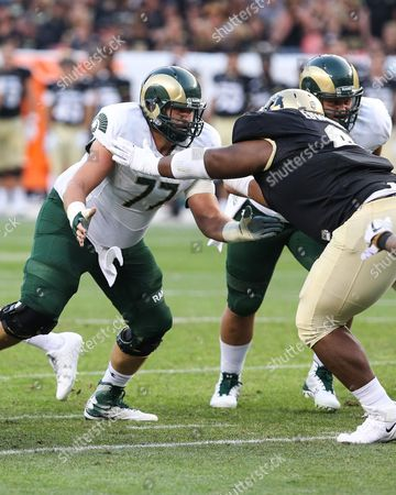 Colorado State offensive lineman Jake Bennett prepares to block Colorado's Javier Edwards in the first half of the Rocky Mountain Showdown in Denver. The Rams lost 17-3