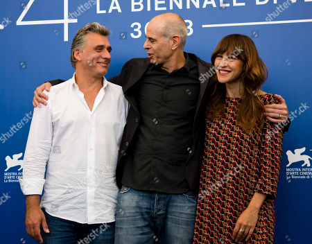 "Samuel Maoz, Lior Ashkenazi, Sarah Adler Director Samuel Maoz, center, and actors Lior Ashkenazi, left, and Sarah Adler pose during the photo call for the film ""Foxtrot"" at the 74th Venice Film Festival in Venice, Italy"