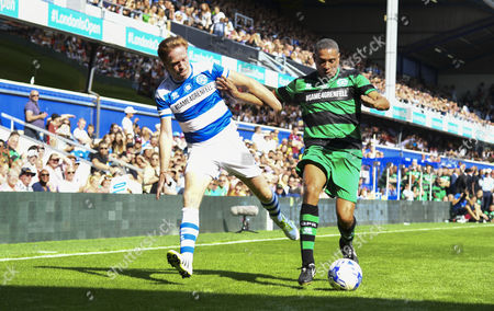 Stock Picture of Damian Lewis of Team Ferdinand looks to get past Des Walker of Team Shearer