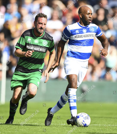Lee Mack of Team Shearer chases DJ Spoony of Team Ferdinand