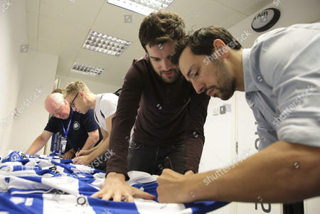 Russell Howard, Ralf Little and Jack Whitehall sign shirts