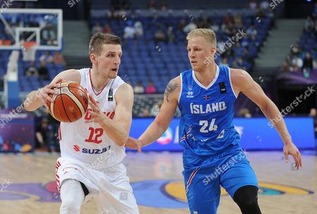 Adam Waczynski of Poland Haukur Palsson of Iceland