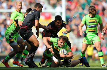 Tom Collins of Northampton Saints is tackled by Dominic Day of Saracens during the Aviva Premiership match between Saracens and Northampton Saints at Twickenham Stadium on September 2, 2017 in London, England. (Photo by Phil Mingo/PPAUK)