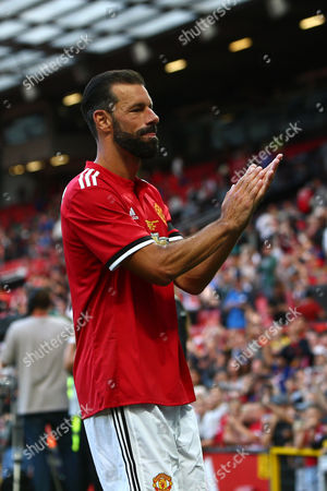 Ruud van Nistelrooy of Manchester United applauds the fans