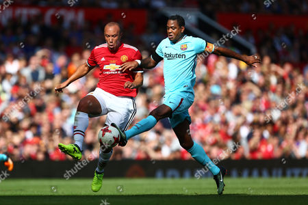 Mikael Silvestre of Manchester United and Patrick Kluivert of Barcelona