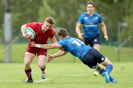 Munster U19 vs Leinster. Munster?s Jonathan Wren is tackled by Leinster?s Robert Russell