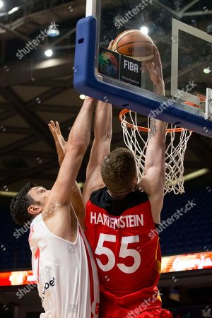 Isaiah Hartenstein, Zaza Pachulia Germany's Isaiah Hartenstein, right, dunkes the ball past Georgia's Zaza Pachulia during their Eurobasket European Basketball Championship Group B match in Tel Aviv, Israel
