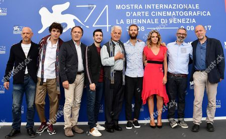 (L-R) Italian actors Filippo Nigro, Eduardo Valdarnini, Francesco Acquaroli, Giacomo Ferrara, Italian director Michele Placido, Italian actors Alessandro Borghi, Claudia Gerini, and Italian directors Giuseppe Capotodi and Andrea Molaioli pose during a photocall for 'Suburra la serie' at the 74th annual Venice International Film Festival, in Venice, Italy, 02 September 2017. The festival runs from 30 August to 09 September.