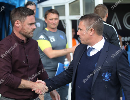 Scunthorpe United manager Graham Alexander (L) and Bury manager Lee Clark before the game