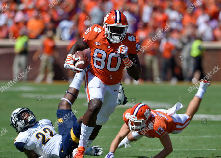 Milan Richardson, Jim Jones, Hunter Renfrow Clemson's Milan Richardson (80) evades Kent State's Jim Jones (22) after a reception with blocking help from Hunter Renfrow during the first half of an NCAA college football game, in Clemson, S.C