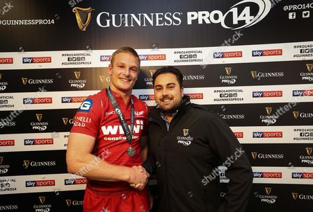 Scarlets vs Southern Kings. ScarletÕs Johnny McNicholl receives his Guinness Pro14 Man of the Match Award from Sam Howard