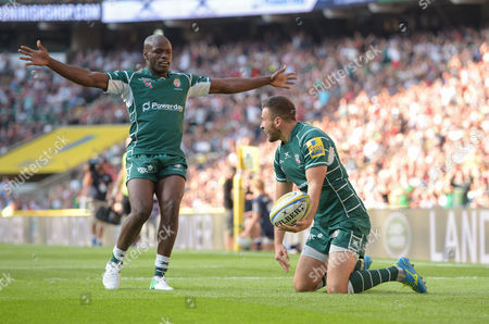 Tommy Bell of London Irish celebrates his goal with Topsy Ojo.