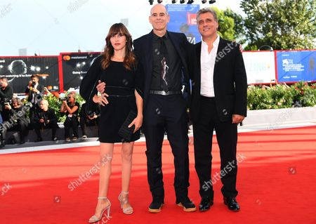 Israeli actor Lior Ashkenazi (R), Israeli movie director Samuel Maoz (C) and French and Israeli actress Sarah Adler (L) arrive for the premier of 'Foxtrot' at the 74th annual Venice International Film Festival, in Venice, Italy, 02 September 2017. The movie is presented in the official competition 'Venezia 74' at the festival running from 30 August to 09 September.