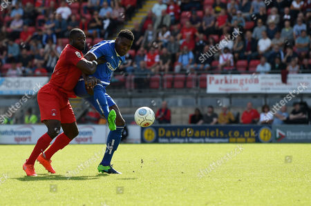 Kayode Odejayi of Guiseley AFC holds off George Elokobi of Leyton Orient during the Vanarama Conference National League match between Leyton Orient and Guiseley AFC at The Matchroom Stadium, Leyton, London on September 2.