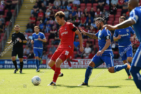 David Mooney, Captain of Leyton Orient breaks clear of Daniel Lowe, Captain of Guiseley AFC during the Vanarama Conference National League match between Leyton Orient and Guiseley AFC at The Matchroom Stadium, Leyton, London on September 2.