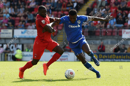 Kayode Odejayi of Guiseley AFC battles with George Elokobi of Leyton Orient during the Vanarama Conference National League match between Leyton Orient and Guiseley AFC at The Matchroom Stadium, Leyton, London on September 2.