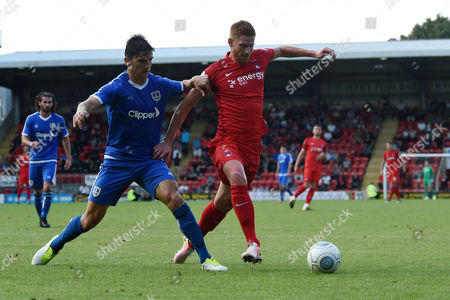 Matt Harrold of Leyton Orient battles with Ashley Palmer of Guiseley AFC during the Vanarama Conference National League match between Leyton Orient and Guiseley AFC at The Matchroom Stadium, Leyton, London on September 2.