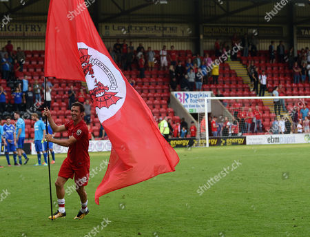 David Mooney, Captain of Leyton Orient waves a flag after the Vanarama Conference National League match between Leyton Orient and Guiseley AFC at The Matchroom Stadium, Leyton, London on September 2.