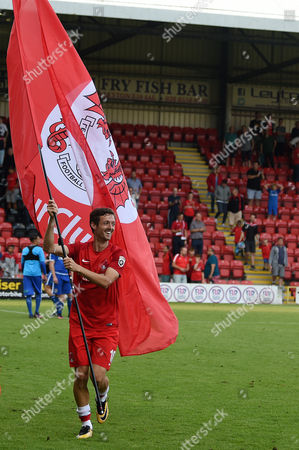 David Mooney, Captain of Leyton Orient waves a flag after during the Vanarama Conference National League match between Leyton Orient and Guiseley AFC at The Matchroom Stadium, Leyton, London on September 2.