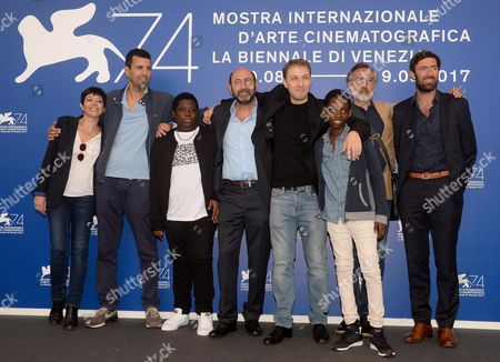 Algerian film director Rachid Hami (4-R),  poses with all cast during a photocall for 'La Melodie' during the 74th Venice Film Festival in Venice, Italy, 02 September 2017. The movie is presented in out competition at the festival running from 30 August to 09 September 2017.