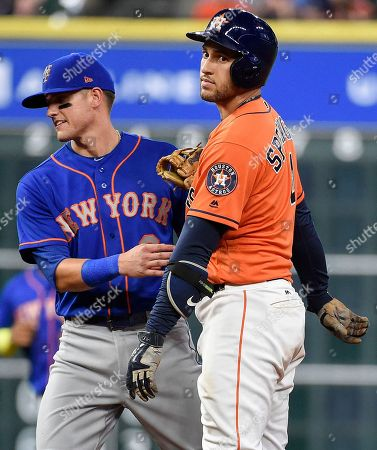 Stock Photo of Gavin Cecchini, George Springer Houston Astros' George Springer, right, is tagged out by New York Mets second baseman Gavin Cecchini after trying to stretch an infield single during the fifth inning of the second game of a baseball doubleheader, in Houston