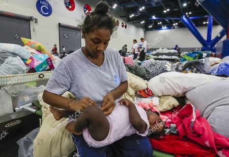 Elizabeth Hunter dresses her one year old daughter Amiyah Smith in the Red Cross shelter set up for Hurricane Harvey flood victims at the George R. Brown Convention Center in Houston, Texas, USA, 02 September 2017. Hurricane Harvey made landfall on the south coast of Texas as a major hurricane category 4. The last time a major hurricane of this size hit the United States was in 2005.
