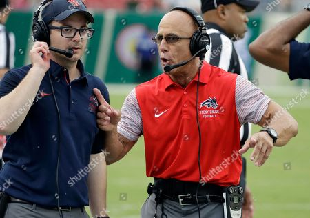 Steve Martino, Chuck Priore Stony Brook head coach Chuck Priore, right, talks to tight ends coach Steve Martino during the second quarter of an NCAA college football game against the South Florida, in Tampa, Fla