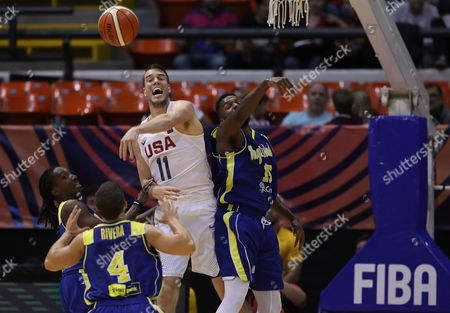 Stock Photo of Marshall Plumlee (C) of USA in action during a match between USA and Virgin Islands of the AmeriCup 2017 semifinal, held at the Orfeo Stadium in Cordoba, Argentina, on 02 September 2017.