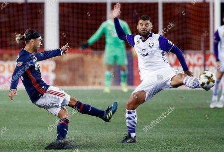 Lee Nguyen, Antonio Nocerino New England Revolution's Lee Nguyen, left, kicks the ball past Orlando City SC's Antonio Nocerino during the first half of an MLS soccer game in Foxborough, Mass