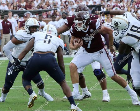 Nick Fitzgerald, Solomon Brown, J.D. Sosebee, Johnny Robinson Mississippi State quarterback Nick Fitzgerald (7) is surrounded by Charleston Southern players, including linebackers Solomon Brown, left, J.D. Sosebee (5) and defensive lineman Johnny Robinson (18), during the first half of an NCAA college football game in Starkville, Miss